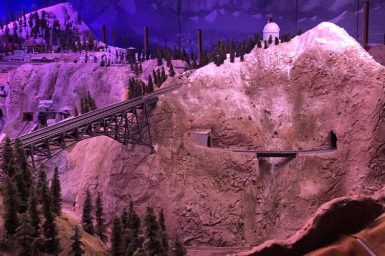 Programmer Zach Moore created a 35-minute sunrise to sunset sequence to paint the model railroad with color.