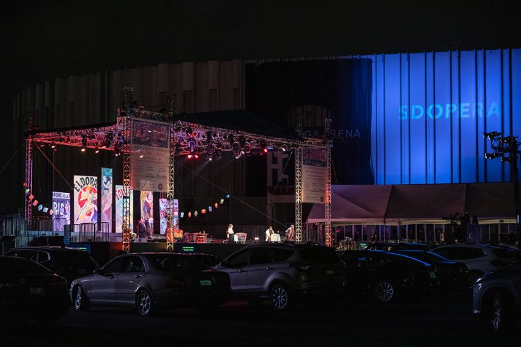 "San Diego Opera produced a full run of La Bohème performed ""drive-in"" style in the parking lot of a local arena. Photo by Karli Cadel."